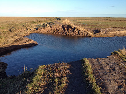 Damaged flood bank between Cley and Salthouse